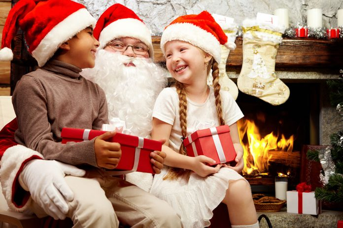 kids-on-santas-lap-with-gifts.
